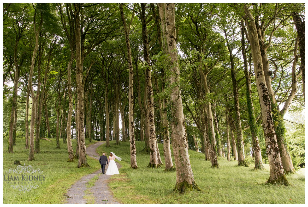 Kasia And Stan walking in the forrest at Glasson Country House Hotel Wedding, Athlone, Co. Westmeath