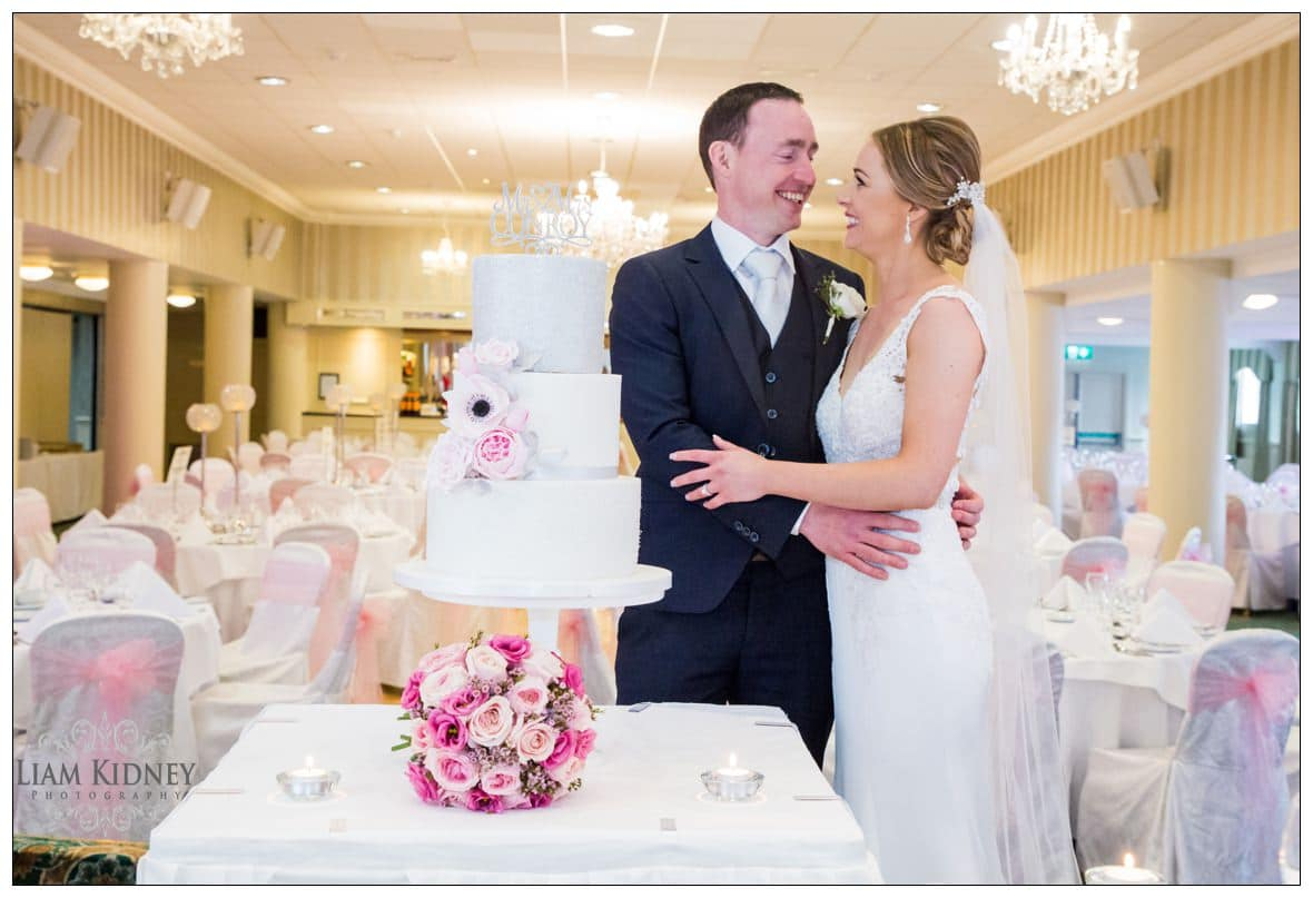 Patricia and Thomas with Wedding cake in Bloomfield House Hotel