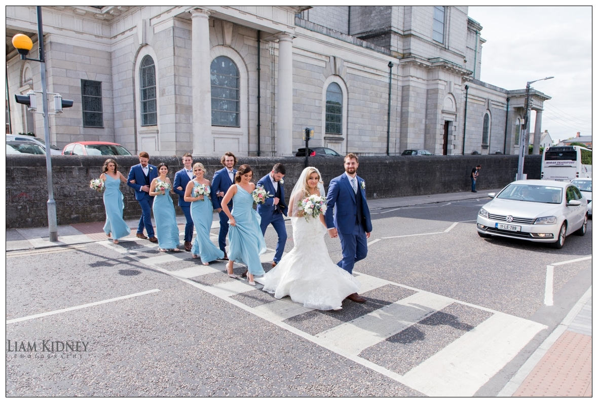The wedding party leave St Peter and Paul's church