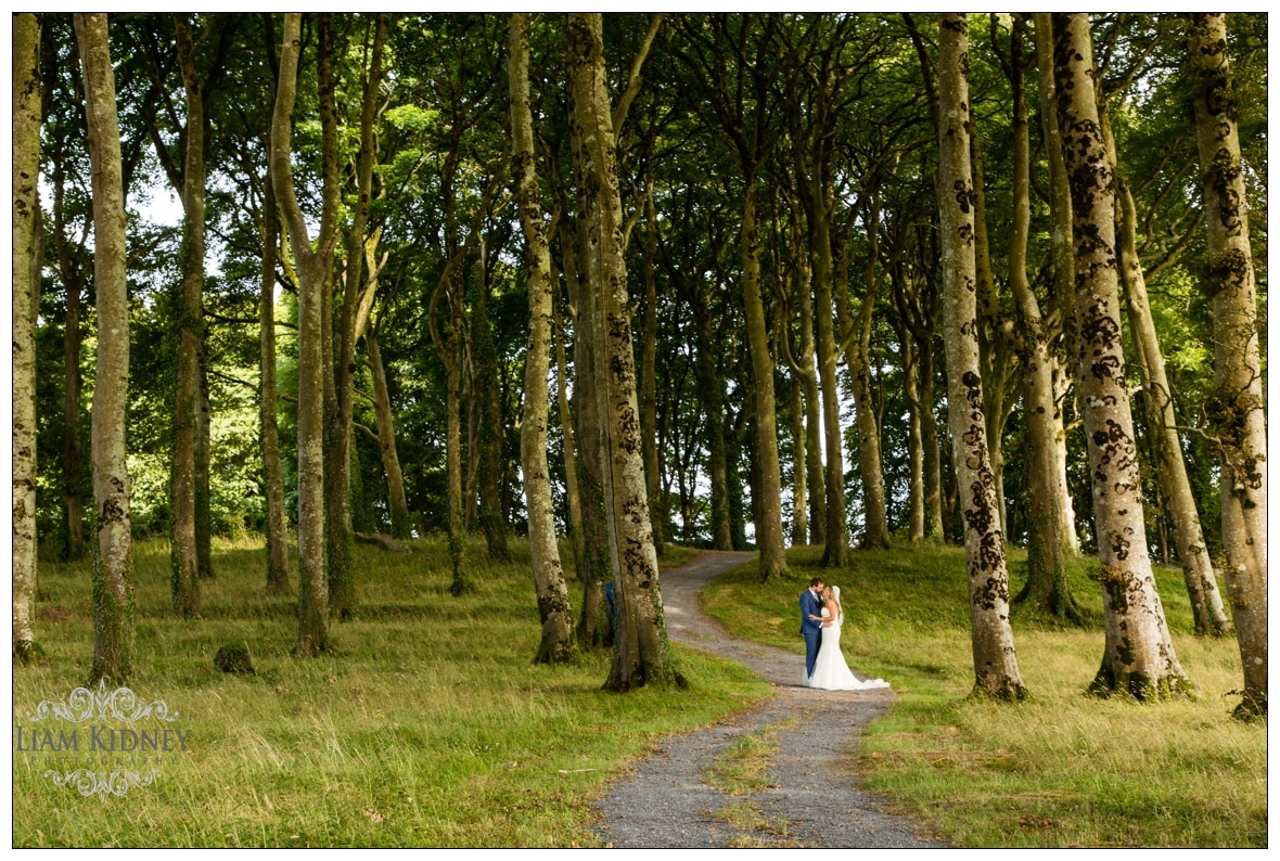 Sarah And Torin in the woods of Glasson Country House Hotel Wedding